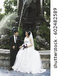 Small photo of Hanoi, Vietnam - October 25, 2016: Undefined Vietnamese couple shooting for wedding photo album in Garden park in Hanoi ,It'is a very important job for the customary marriage, image wedding background
