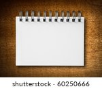blank white notebook on wood background - stock photo