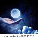 moon planet in hand . mixed... | Shutterstock . vector #602519315