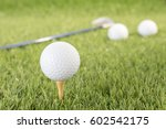 golf ball sitting on tee... | Shutterstock . vector #602542175