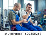 two worker in factory have a...   Shutterstock . vector #602565269