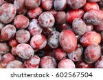 picture of a closeup ripe plum... | Shutterstock . vector #602567504
