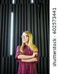 woman standing near wall... | Shutterstock . vector #602573441