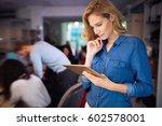 businesswoman working in... | Shutterstock . vector #602578001
