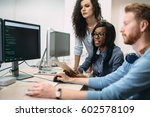 programmers cooperating at  it... | Shutterstock . vector #602578109