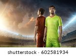 two soccer players on a stadium | Shutterstock . vector #602581934