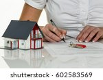 woman signs agreement for house | Shutterstock . vector #602583569