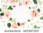 Stock photo floral round frame with pink roses and leaves on white background flat lay top view frame 602587205