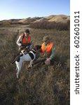 two men  bird hunters  with...   Shutterstock . vector #602601011