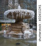 Small photo of Icicles suspended from the frozen Josephine Shaw Lowell Memorial Fountain in Bryant Park in winter