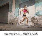 a woman running along an urban... | Shutterstock . vector #602617985