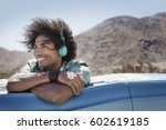 a young man with music... | Shutterstock . vector #602619185
