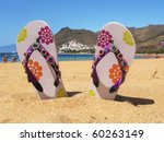 Flip-flops in the sand of Teresitas beach. Tenerife island, Canaries - stock photo