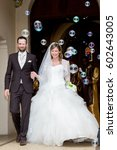 the groom and the bride leave... | Shutterstock . vector #602643005
