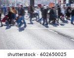 many pedestrians cross a street | Shutterstock . vector #602650025