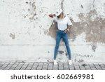 hipster girl wearing blank... | Shutterstock . vector #602669981