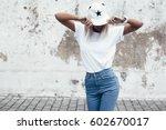 hipster girl wearing blank... | Shutterstock . vector #602670017