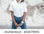 hipster girl wearing blank... | Shutterstock . vector #602670041