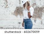 hipster girl wearing blank... | Shutterstock . vector #602670059