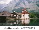 church near the lake in front... | Shutterstock . vector #602692019
