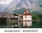 church near the lake in front... | Shutterstock . vector #602692019