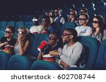 couple eating popcorn and... | Shutterstock . vector #602708744