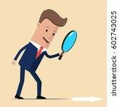 businessman looking through a... | Shutterstock .eps vector #602743025