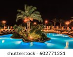 tropical swimming pool in night ... | Shutterstock . vector #602771231