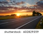 sunset over the asphalt road in ... | Shutterstock . vector #602829359
