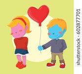 blue boy giving heart shaped... | Shutterstock . vector #602877701