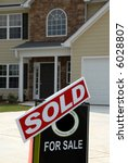 SOLD Sign in Front of a New Home - stock photo
