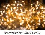 glittering stars on bokeh of... | Shutterstock . vector #602915939