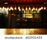 wood background with blur lamp... | Shutterstock . vector #602931455