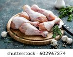 raw uncooked chicken legs ... | Shutterstock . vector #602967374
