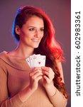 beautiful brunette holding four ... | Shutterstock . vector #602983361