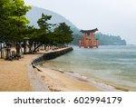 Stock photo scenery of sea coast on miyajima island viewing the famous orange floating japanese shinto gate 602994179