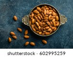Almond Nuts On Dark Background...