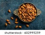 Almond Nuts On Dark Background...
