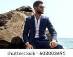 man in elegant suite posing in... | Shutterstock . vector #603003695