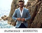 man in elegant suite posing in... | Shutterstock . vector #603003701