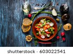 vegetarian salad on rustic... | Shutterstock . vector #603022541
