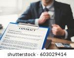 businessman keeping money into... | Shutterstock . vector #603029414