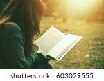 woman relaxing reading in park. ... | Shutterstock . vector #603029555