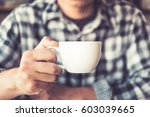 closeup hand of male holding a... | Shutterstock . vector #603039665