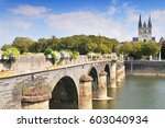 View of Angars with bridge and cathedral St Maurice France.
