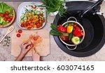 top view of child hands slicing ...   Shutterstock . vector #603074165