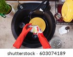 hands with red latex gloves... | Shutterstock . vector #603074189