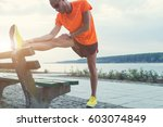urban jogger stretching  ... | Shutterstock . vector #603074849