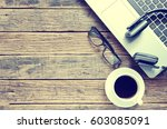 coffee and laptop on wooden... | Shutterstock . vector #603085091