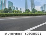 clean asphalt road with city... | Shutterstock . vector #603085331
